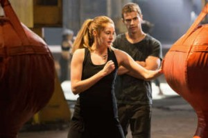 "Tough love: Actors Shailene Woodley (centre) and Theo James (right) star as Tris and Four, love interests in ""Divergent"". Photo courtesy of Lionsgate."