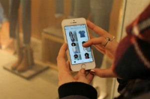 Shoppers can access a retailer's website or app by connecting via mobile device. [Photo © Mackenzie Kearnan]