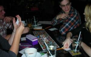 Kayla Schultz, Daniel Kolanko & friends are regulars at Ottawa's board game cafés/lounges. [©Melissa Novacaska]