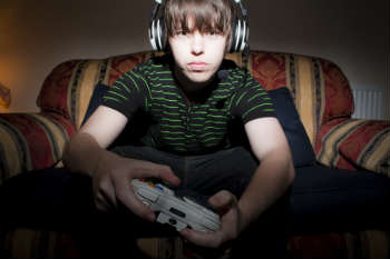 Online gamers can communicate via headset with others, which leads to exchanges of insults and threats. (Photo © Ross Heale-Whittle)