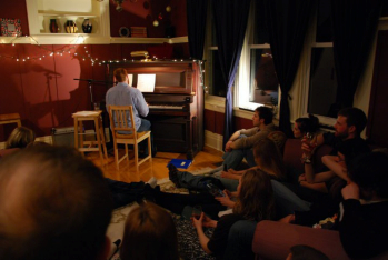 Folk singer Joe Cousineau, performing in June 2011 at Westboro House Concerts, held in Nicole Colbeck's house in Ottawa.  [Photo courtesy of N. Colbeck]