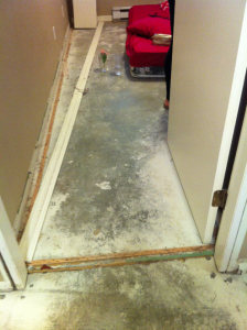 After water damaged the floor, Donahue returned to cold concrete, dust and exposed nails.