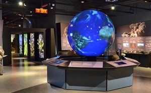 An interactive globe allows visitors to enact different scenarios using controls.